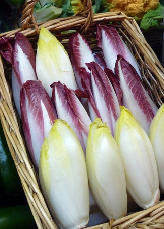 Belgian endives in basket at produce market