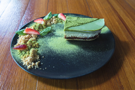 Matcha green tea ice cream cake with strawberry and cookie crumble Stock Photo