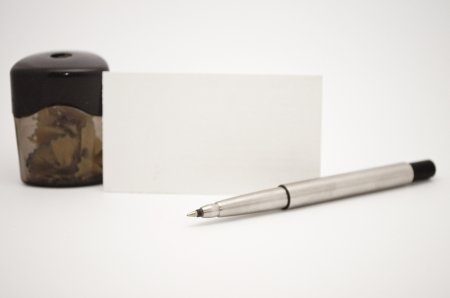 sharpener, pen and card photo