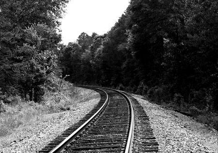 Moderately curved railroad tracks - black and white