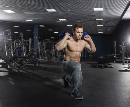 Portrait Of A Young Athlete Man Working With Fitness Bag In The