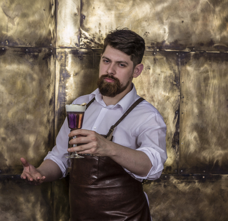 Portrait of brutal  bartender standing and smiling in bar Stock Photo