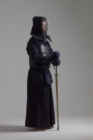Portrait of man kendo fighter with shinai. Shot in studio Stock Photo