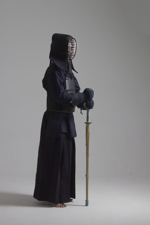 Portrait of man kendo fighter with shinai . Shot in studio Stock Photo