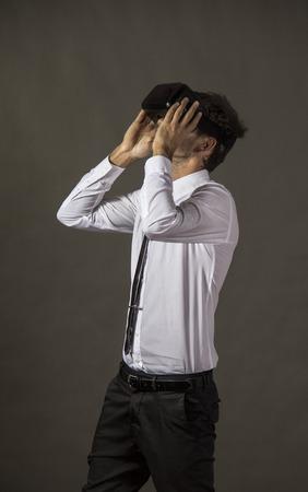 Handsome Man using virtual reality headset.Studio shot Stock Photo