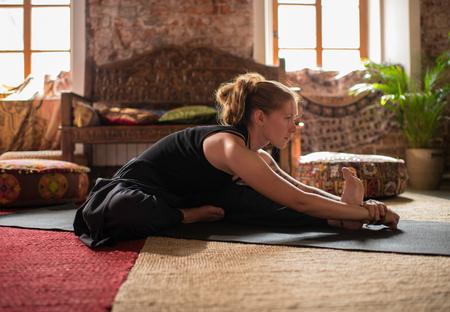 Woman Doing Yoga In Studio