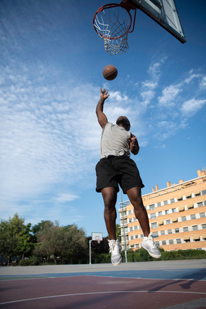 African American Basketball Player Scoring while he is playing streetball Stock Photo