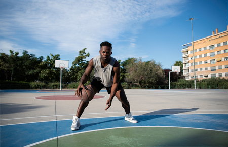 Young African American Man Playing Streetball Outside Stock Photo
