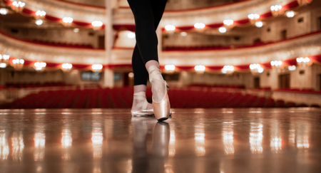 The close up of shoes of young Professional Ballerina on the sta Banco de Imagens