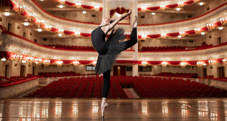 Young Ballerina dancing on the stage of amazing theatre. Banque d'images