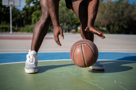 Close up of the hands of Young African American Athletic  man pl Stock Photo