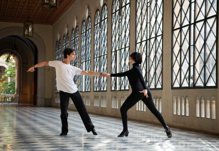 Professional ballroom dancers dancing passionately while practicing alone