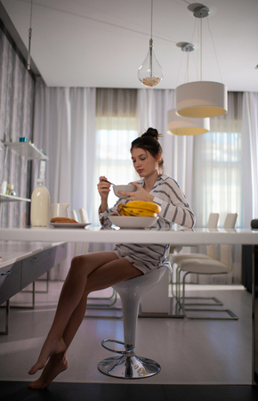 Woman Eating A Healthy Breakfast At Home