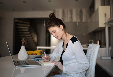 Woman Working From Her Studio Office At Home