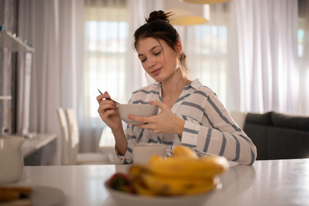Cheerful Woman Eating A Healthy Breakfast At Home Reklamní fotografie