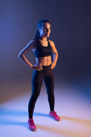 Sporty fit woman ready for training and looking away Archivio Fotografico