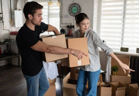 The Couple arranging boxes in new apartment
