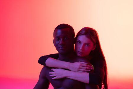 Woman embracing man during studio shot