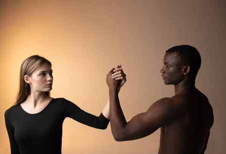 Multiethnic united couple holding the hands together