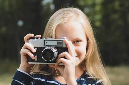 rangefinder: Cute little girl with a vintage rangefinder camera. Beautiful long blond hair.