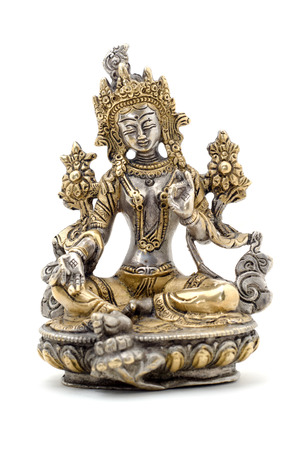 tara: Statuette of Green Tara on a white background. Vajrayana deity, quick to help and protection. Om tare tuttare ture soha.