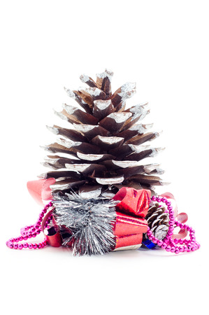 Christmas pine cone with gifts and gift bow isolated on white.