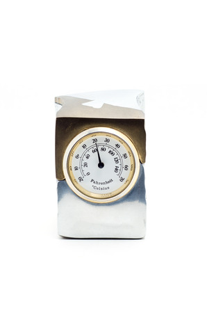 hygrometer: Gift thermometer in a metal case on a white background.