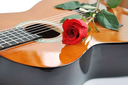 single songs: Classical guitar and rose. Stock Photo