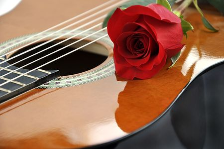 Classical guitar and rose. Stock Photo - 5030394