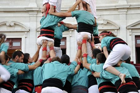 strength in unity: Human castle. Group of people (castellers) building human castle at traditional festivities in Catalonia (Spain).  Stock Photo
