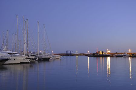 Evening port. Yachts on a mooring in Cambrils port. Spain. photo