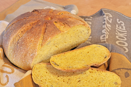 gold flax: Fresh home-baked pumpkin bread with pumpkin and flax seeds. Healthy food concept.