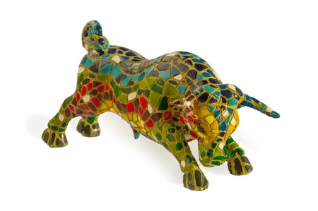 souvenir traditional: Miniature mosaic  statue of bull in Gaudi style - traditional souvenir from Barcelona Spain . Isolated over white. This is not art object, only inexpensive spanish gift. Stock Photo