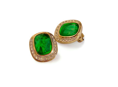 pledge: Pair of stud earrings ear clips with zirconium and green crystal isolated over white. Stock Photo