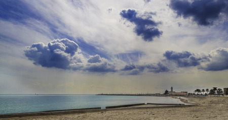 dramatics: Manfredonia, Gargano, Apulia, wide view with clouds and lighthouse on background.