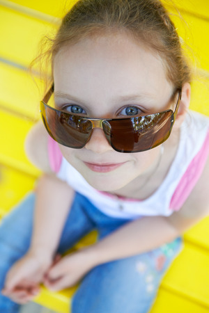 Adorable cute pretty little girl playing outdoors in summer. Happy childhood. photo