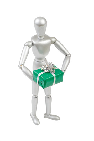 Silver marionette holding a green gift box with big silver bow. Isolated on a white background photo