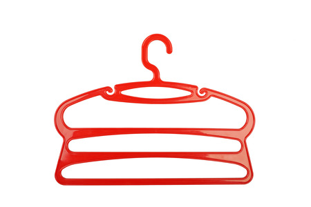 Clothes hanger red plastic isolated on white background. photo