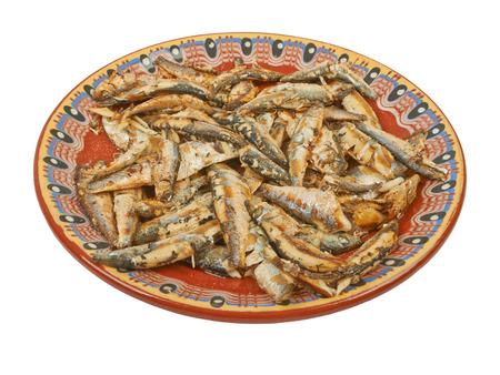 sprats: Fried sprats fish on a plate