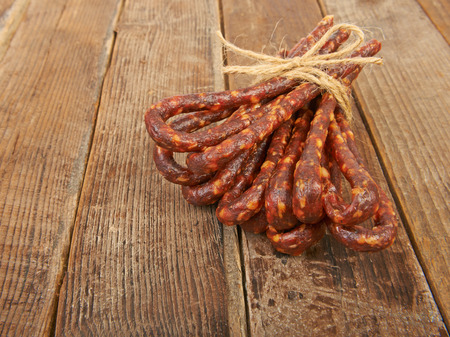 dry sausage: Dry sausage hunting on a wooden table
