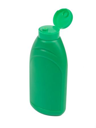 squirting ketchup: Green plastic bottle for ketchup, mayonnaise, mustard or other sauces isolated on white background