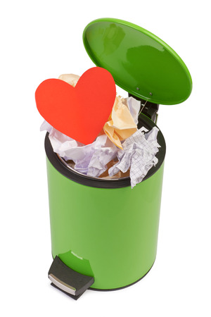 litterbin: Heart thrown in the trash. The concept of separation, termination of a romantic relationship. The loss of love. Isolated on white Stock Photo
