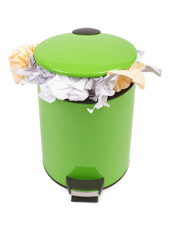 Waste can full up with crumpled paper. Isolated on white background