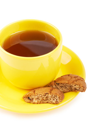 Cup of tea and chocolate cookies on a white background isolated photo