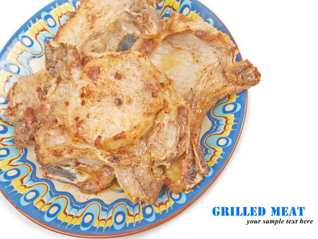 meat grilled: Pork meat grilled on a plate isolated on white Stock Photo