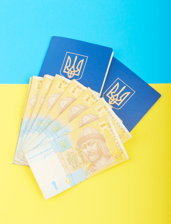 hryvna: Two Ukrainian passport on the flag of the yellow-blue with the national currency