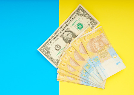 hryvna: Ukrainian hryvnia and the dollar in the flag of the yellow-blue