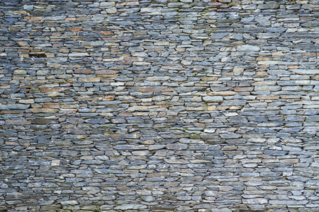 The surface of the stone wall background Banco de Imagens