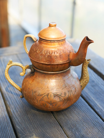 kettles: Turkish copper kettles on a wooden table