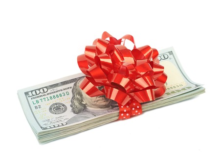 red bills: Hundred-dollar bills tied with red ribbon as a gift isolated on white background
